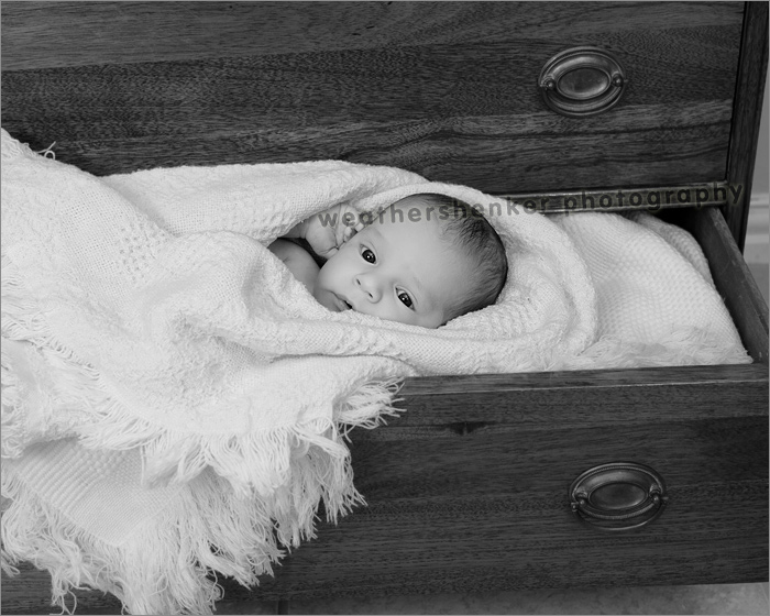 Baby photo of infant in a drawer