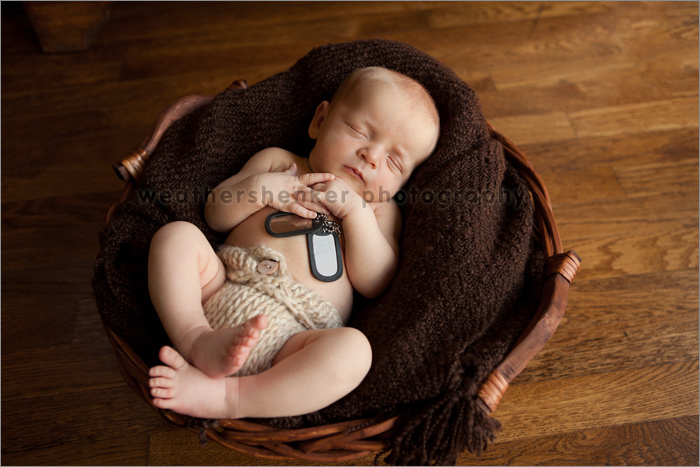 Newborn baby with father's military dog tags