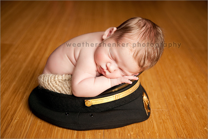 Austin newborn photography of a baby in an airplane pilot hat
